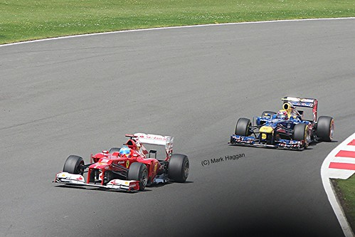 Fernando Alonso in his Ferrari leads Mark Webber in his Red Bull Racing at the 2012 British Grand Prix at Sivlerstone