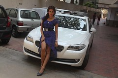 Actress Sanjjanaa with her own BMW 5 series
