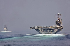 U.S. Navy ships transit the Strait of Hormuz.