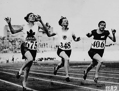 Myrtle Cook of Canada (left) winning a prelimi...