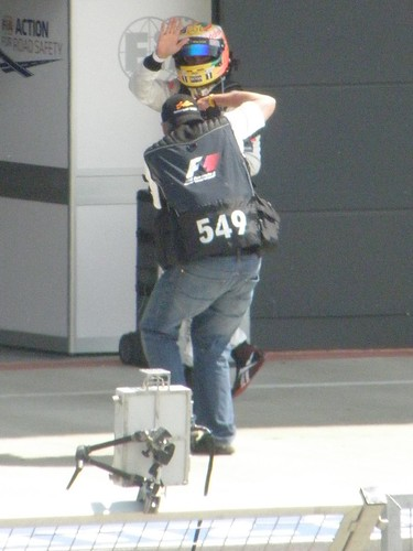 A photographer takes a pic of Lewis Hamilton after the 2011 British Grand Prix at Silverstone