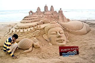 International sand artist Sudarsan Pattnaik welcome the team of British parliamentarian at Puri beach during their visit to Odisha on Monday.