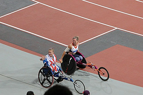 Hannah Cockroft celebrates her gold medal in the T34 200m with Melissa Nicholls at the London 2012 Paralympic Games