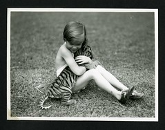 Unidentified child with tiger cub photographed...