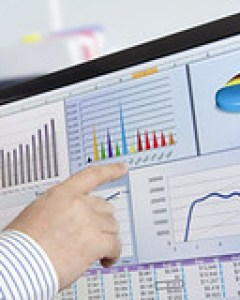 Man analyzing financial data and charts on com...