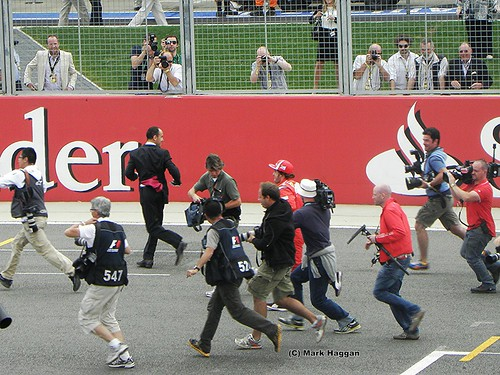 Fernando Alonso misses the drivers parade and runs to get on at the 2011 British Grand Prix