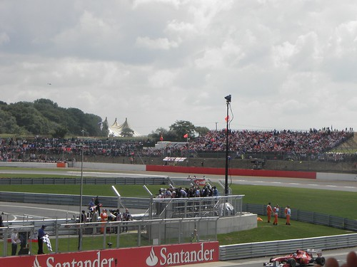 Fernando Alonso returns to the pits after winning the 2011 British Grand Prix at Silverstone