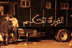 'Revolution Rules' Sprayed on Police Truck