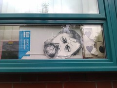 Slavoj Žižek mask at the window