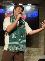 Nathan Fillion demonstrating Harry Potter auction item