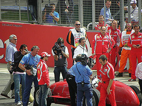 Felipe Massa watches Fernando Alonso race a historic Ferrari at the 2011 British Grand Prix