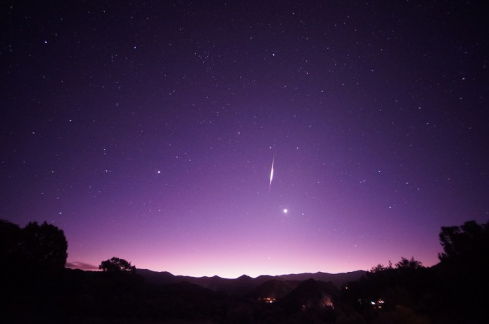 Pre-dawn meteor (probably a Leonid) and Venus. There was an ion train that blew off to the right, so this photo includes some of that afterglow already dispersing in the wider portion of the meteor.
