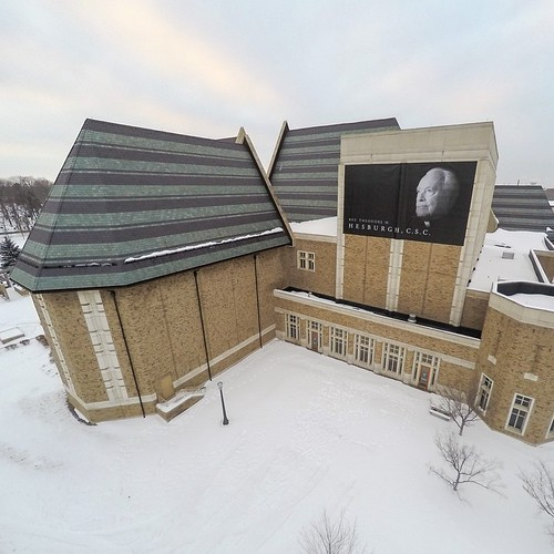 A banner of Fr. Ted hangs on the side of DeBartolo Performing Arts Center (@debartoloartsnd)