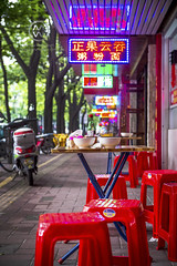 A neon adorned cafe along the streets of Guangzhou, China.