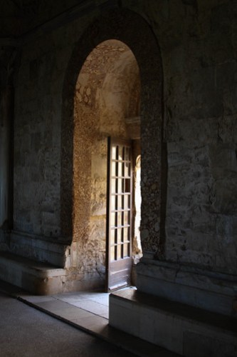 A backlit doorway in Castel del Monte, Puglia