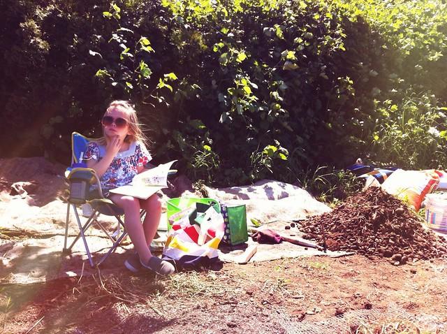 sadie reading at the plot