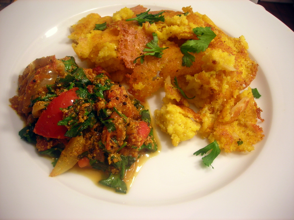 Savory corn-almond pancakes, with spiced tomatoes and onion