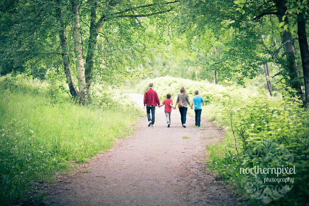family walking ginter's park prince george bc canada