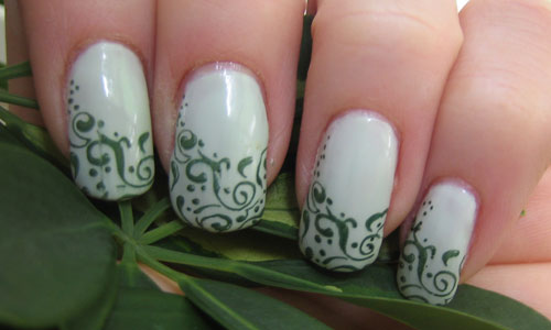 Essie-absolutely-shore-stamped-w-Orly-Enchanted-forest