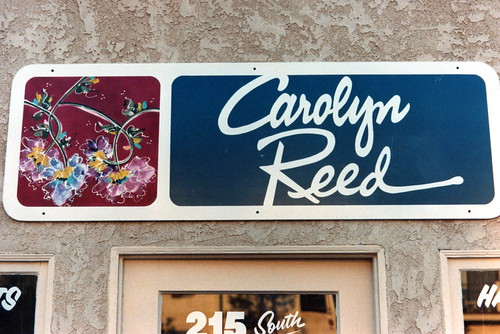CAROLYN REED painted sign