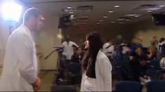 Chris Keefer & Faria Kamal - Doctor and medical student interrupt Minister Joe Oliver at press conference - pix 03