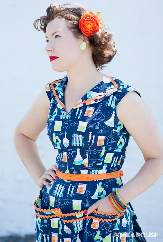 Bright orange rick-rack makes an eye-catching trim on a vintage-inspired novelty print dress