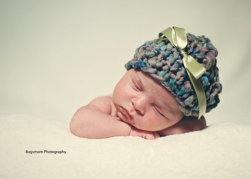 lila in hat with green bow