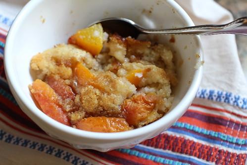 brown butter peach cobbler, served