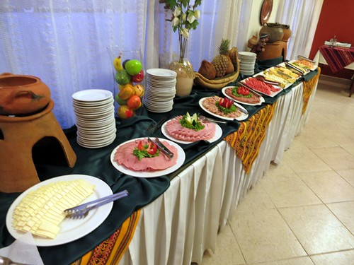 Breakfast buffet (cheese, hams, fruit)