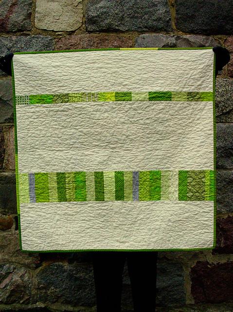 green squares improv baby quilt back