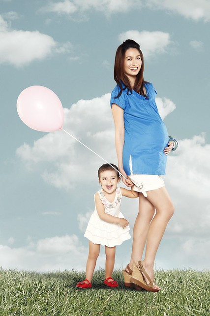 [Photo 6b] - On Danda - Lilac cotton dress with embellished shoulder details. On Jamie - White maternity shorts, Royal Blue cowl neck top