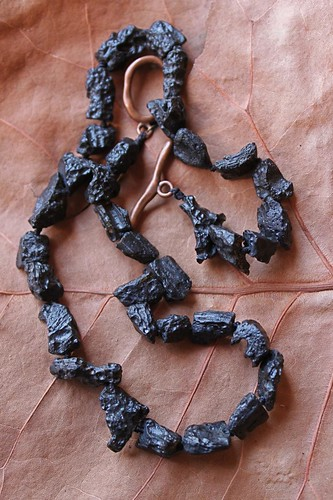 lava chunks & copper made into a necklace by denise carbonell