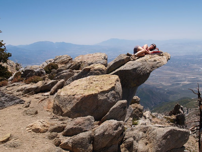 Sleeping on an overhanging boulder near the Cucamonga Peak Summit
