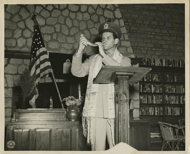 Captain Joseph H. Freedman Hq, USAFIME, is shown blowing the Shofar