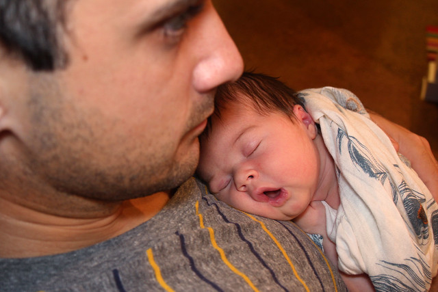 Harper sleeping on daddy