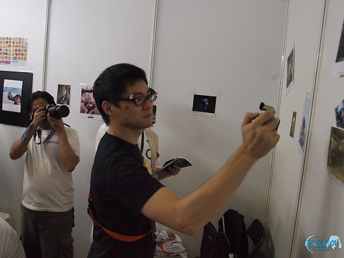 Taking photos of the photo wall