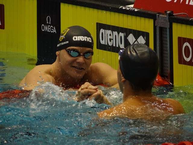 Korotyshkin greets Shields after the 2012 Berlin 100 fly