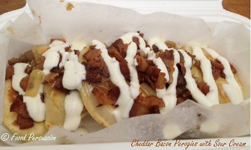 Cheddar perogies with bacon and sour cream @holyperogy Street food city Vancouver