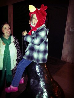 Why, yes, I do have an Angry Birds hat on, and I am sat on a giant statue of a pear!
