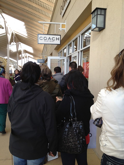 A line to get in at the Coach store