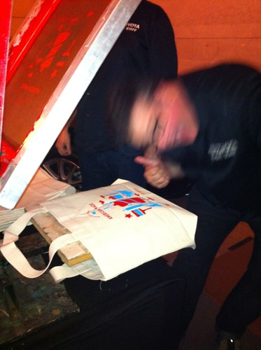 bag silkscreening, red, and loopy guy doing it
