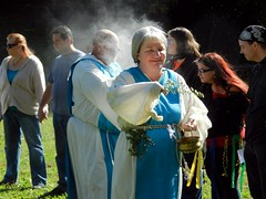 """""""Priests"""" conducting Pagan religious ritual in Wyman Park Dell"""