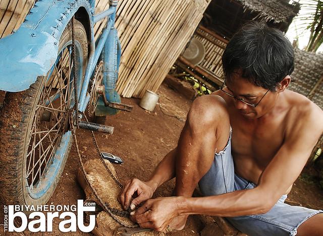 uncle fixing his bike madridejos cebu