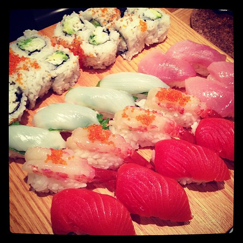 yvonne's amazing spread- sushi goodness by tangerinee