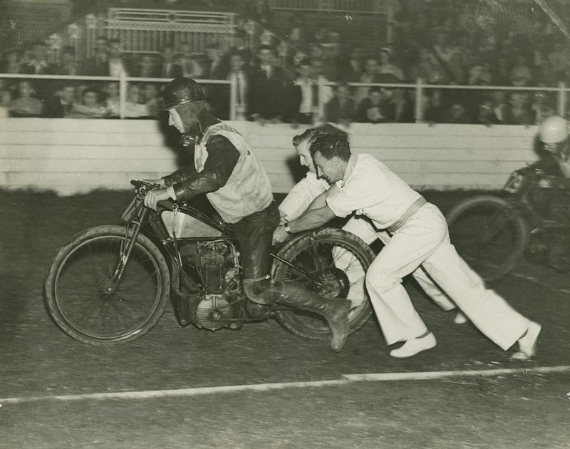 Motor bike racer getting a push start at the track, Brisbane