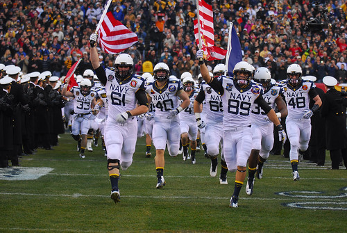 The Navy Midshipmen take the field. by Official U.S. Navy Imagery