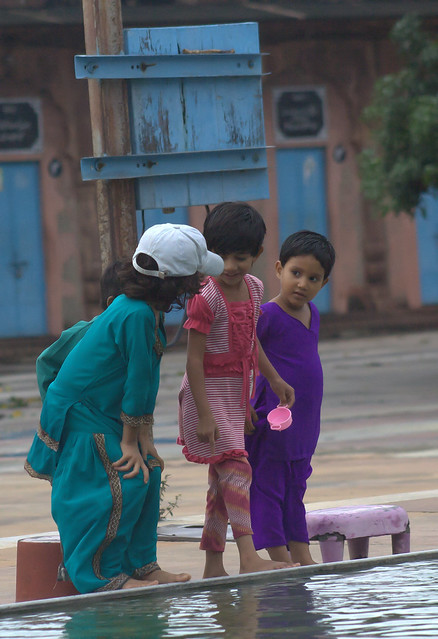 Children playing at the waterfont of mosque