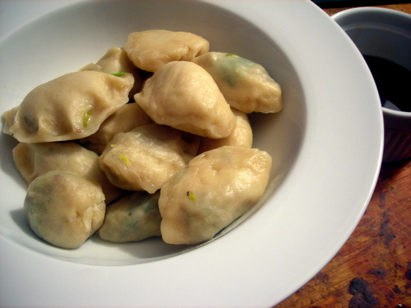 Homemade jiaozi (Chinese dumplings), with brussels sprouts, Cantonese roast duck and serrano pepper