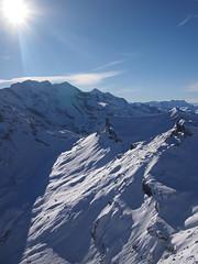 Sun shining on snowy mountains