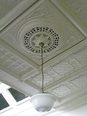 A Light Fixture and a Section of the Art Nouveau Pressed Metal Ceiling in the Restaurant of the Korumburra Railway Station - Station Street, Korumburra